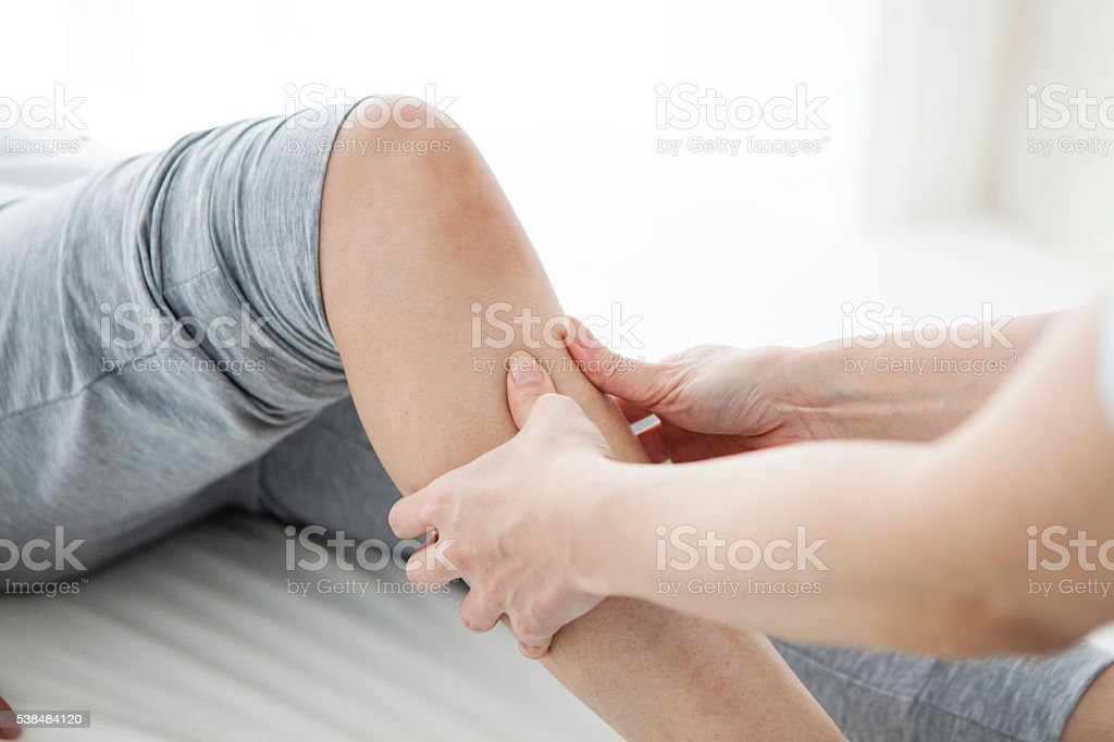 Women have been massaging the foot in the gym stock photo