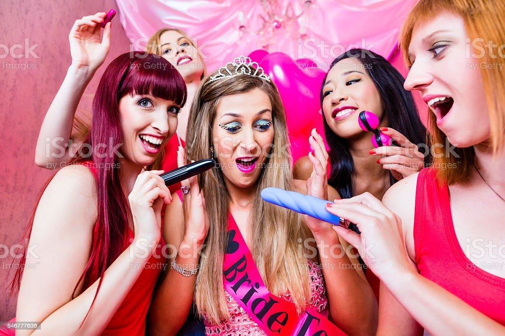 Women having bachelorette party with sex toys in night club stock photo