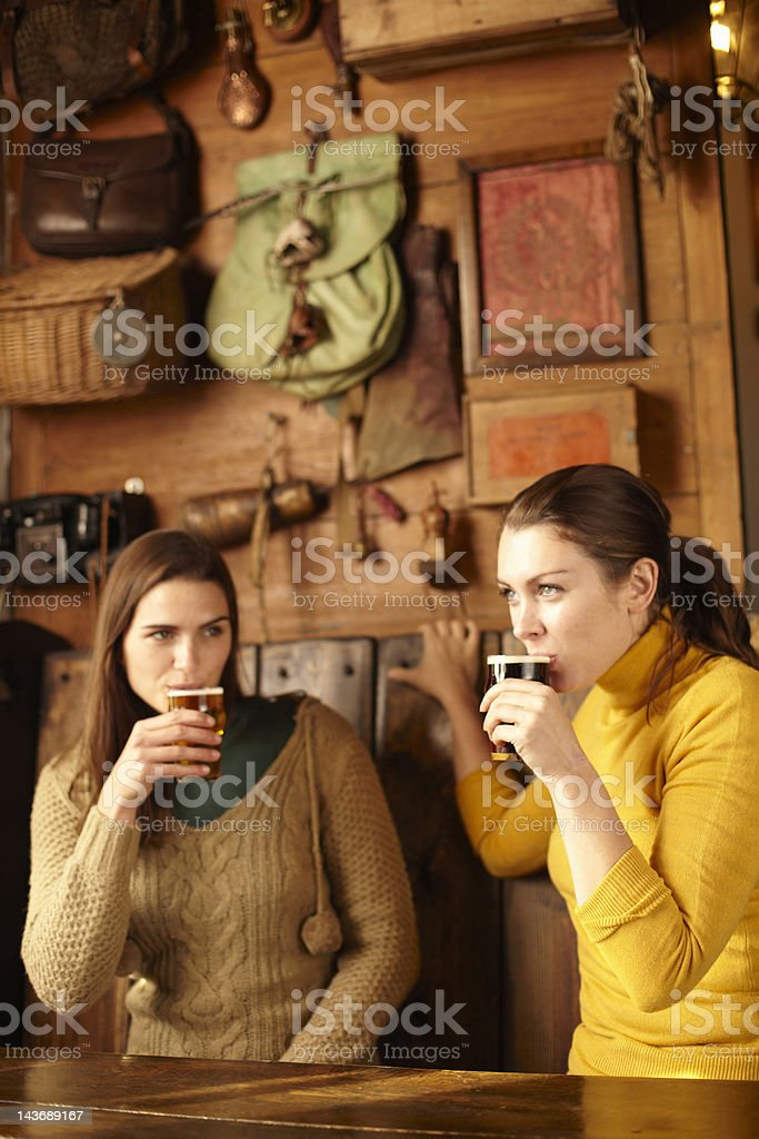 Women having beer in pub stock photo
