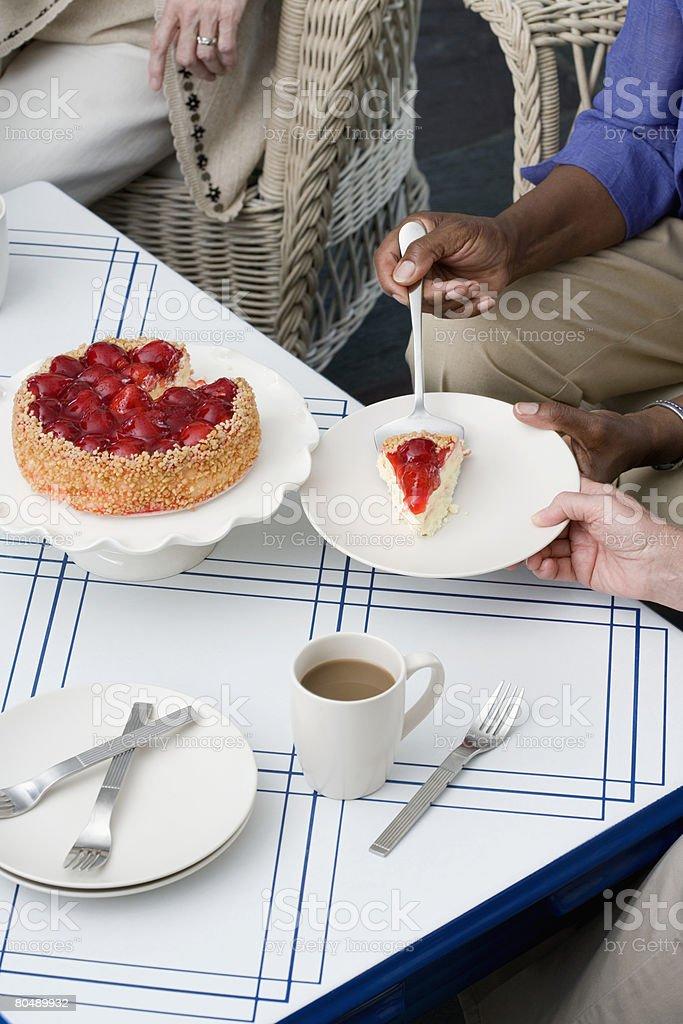 Women having cake royalty-free stock photo