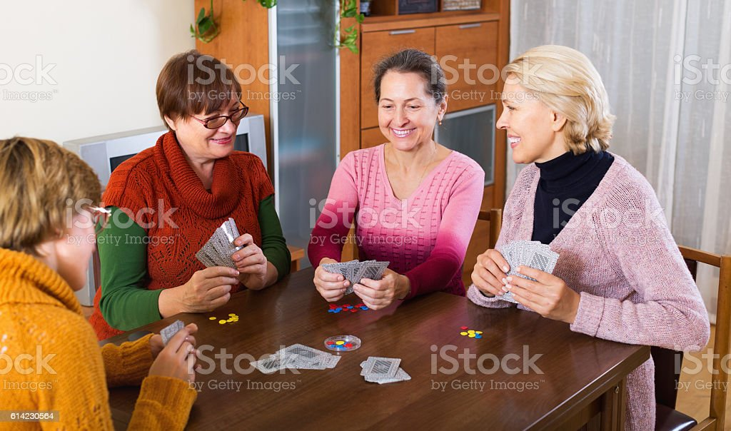 Women having fun with cards stock photo