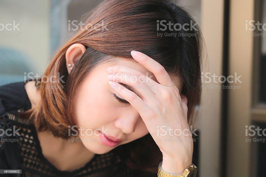 Women having headache, migraine, hangover, insomnia. stock photo