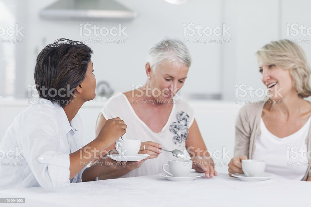 Women having tea together and chatting royalty-free stock photo