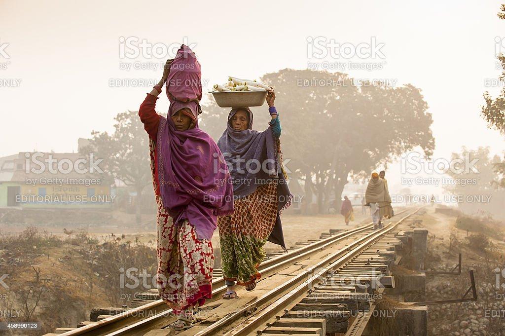 Women heading stuff walking on the railway in misty morning stock photo