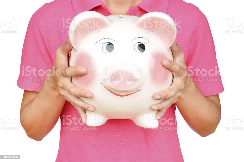 women hold Pink piggy bank stock photo