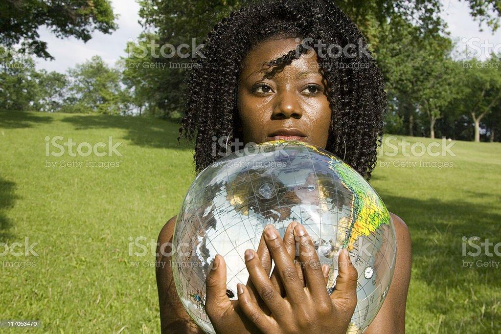 Women Holding Globe In Sunlight. royalty-free stock photo
