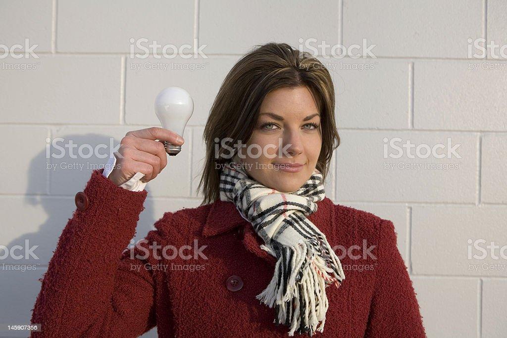 Women Holding Light Bulb With Idea royalty-free stock photo