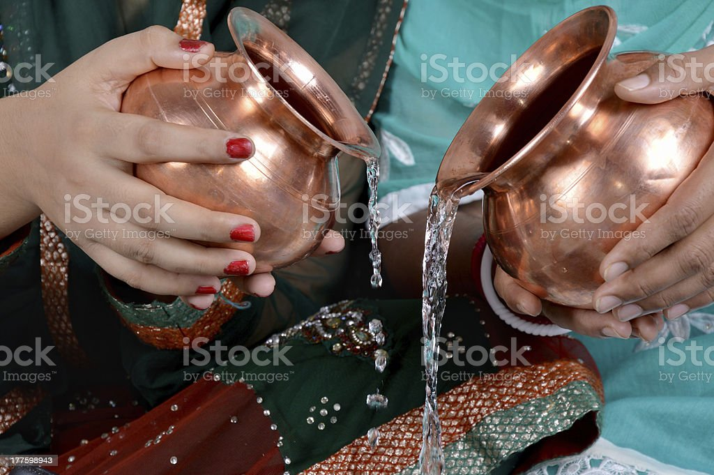 Women Holding Metal Bowl in Hand royalty-free stock photo
