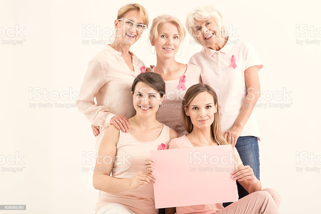 Women holding pink paper card stock photo