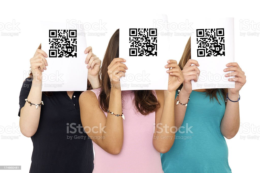 Women Holding QR Code in Front of Face royalty-free stock photo