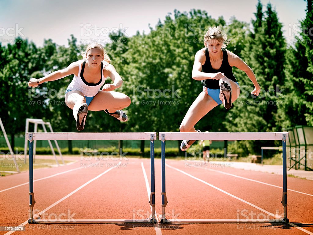 Women Hurdling stock photo
