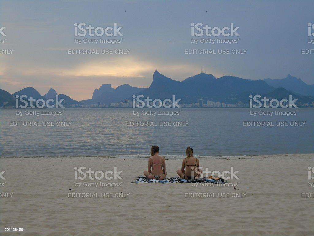 Women in a brazilian beach, Rio de Janeiro, Brazil. stock photo