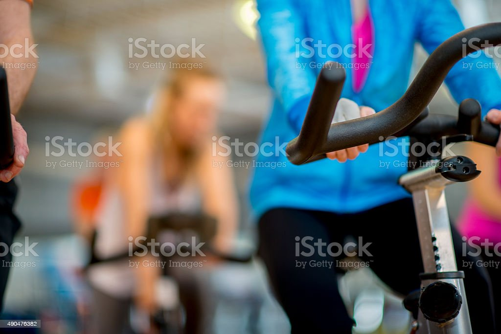 Women in a Cycling Fitness Class stock photo
