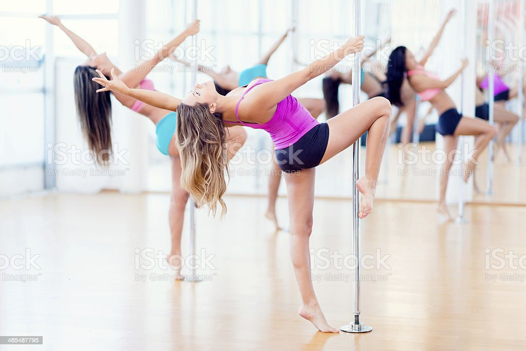 Women in a pole dance class stock photo