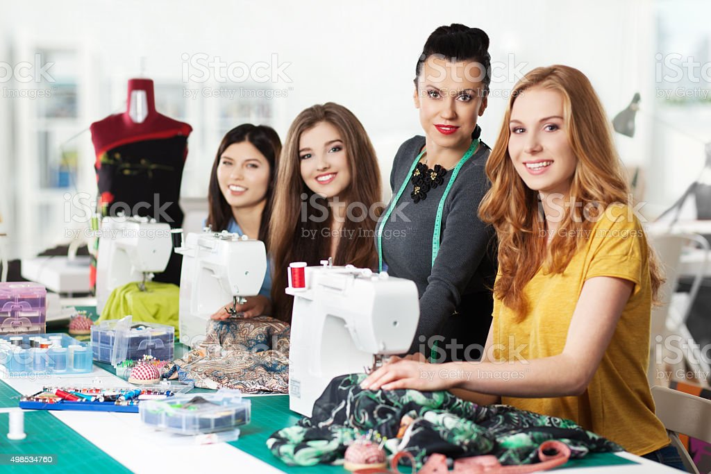 Women in a sewing workshop stock photo
