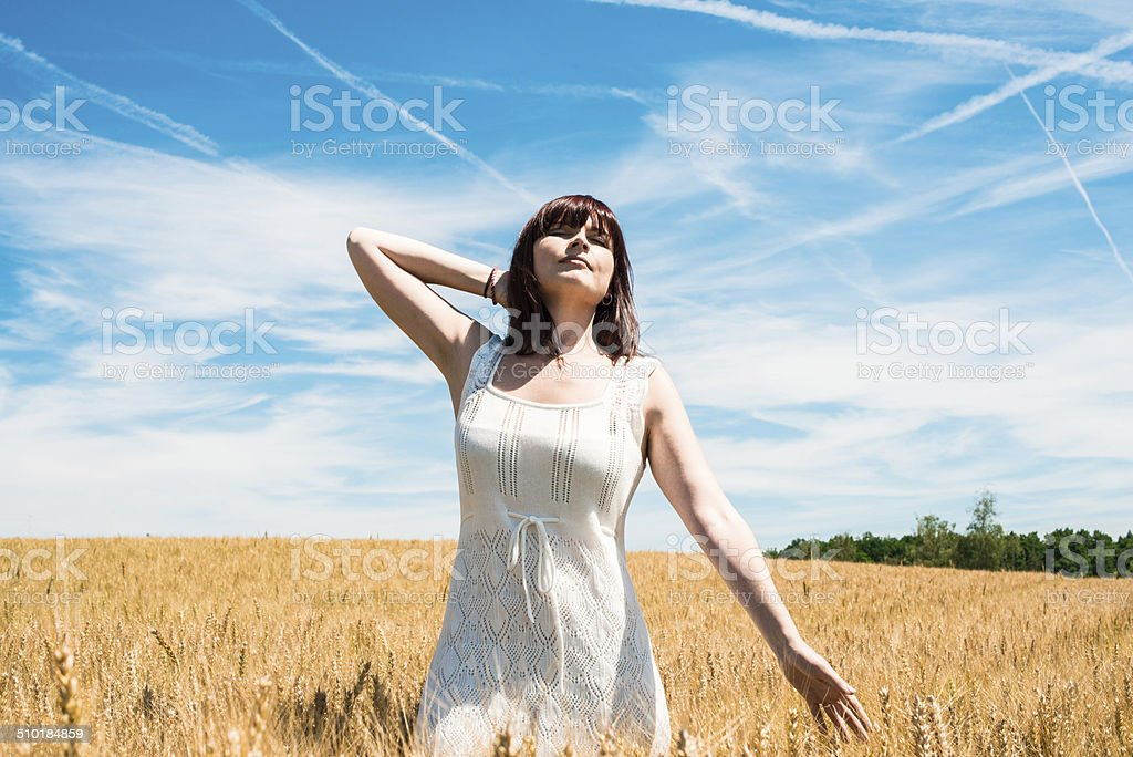 women in a wheat field stock photo