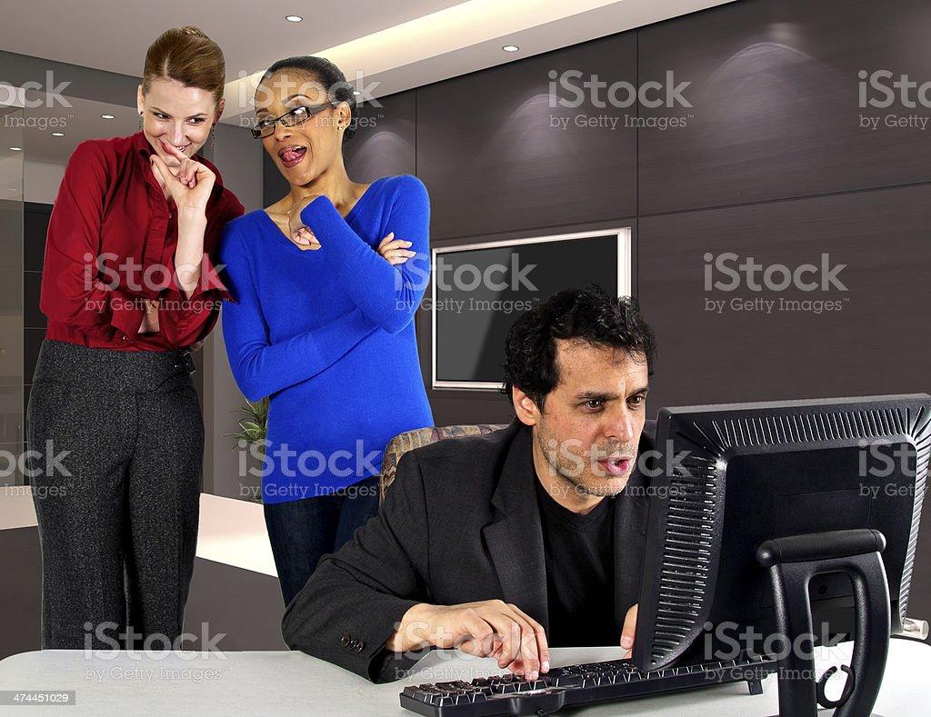Women in an Office Gossip About a Male Employee stock photo