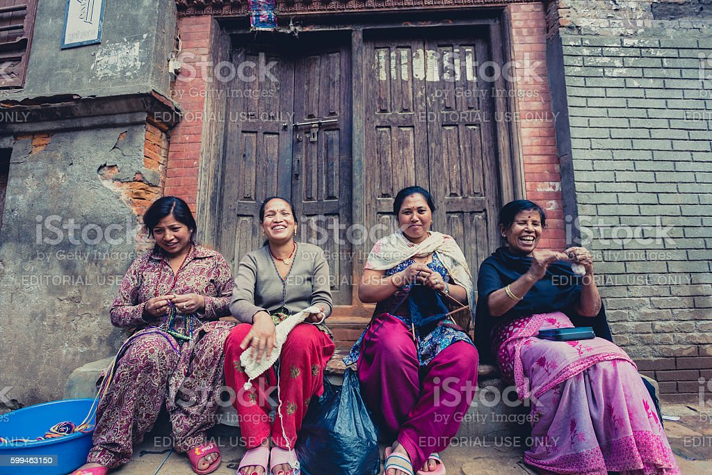 Women in Bhaktapur smiling and working in the street. Nepal stock photo