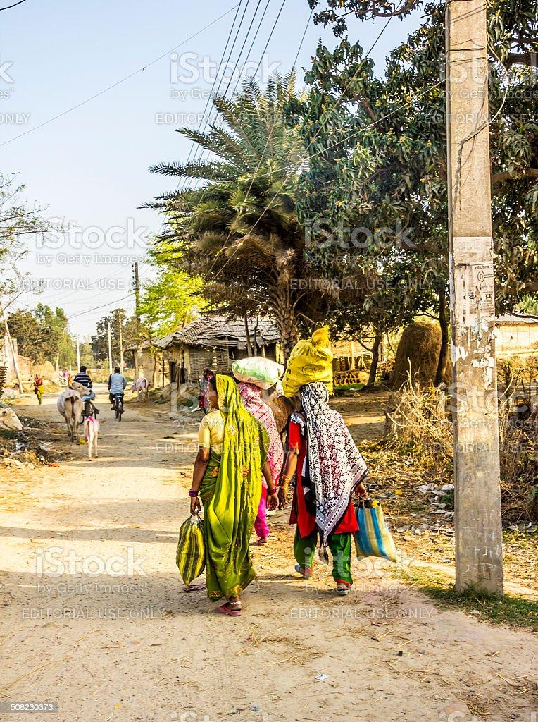 women in colorfol sarees stock photo
