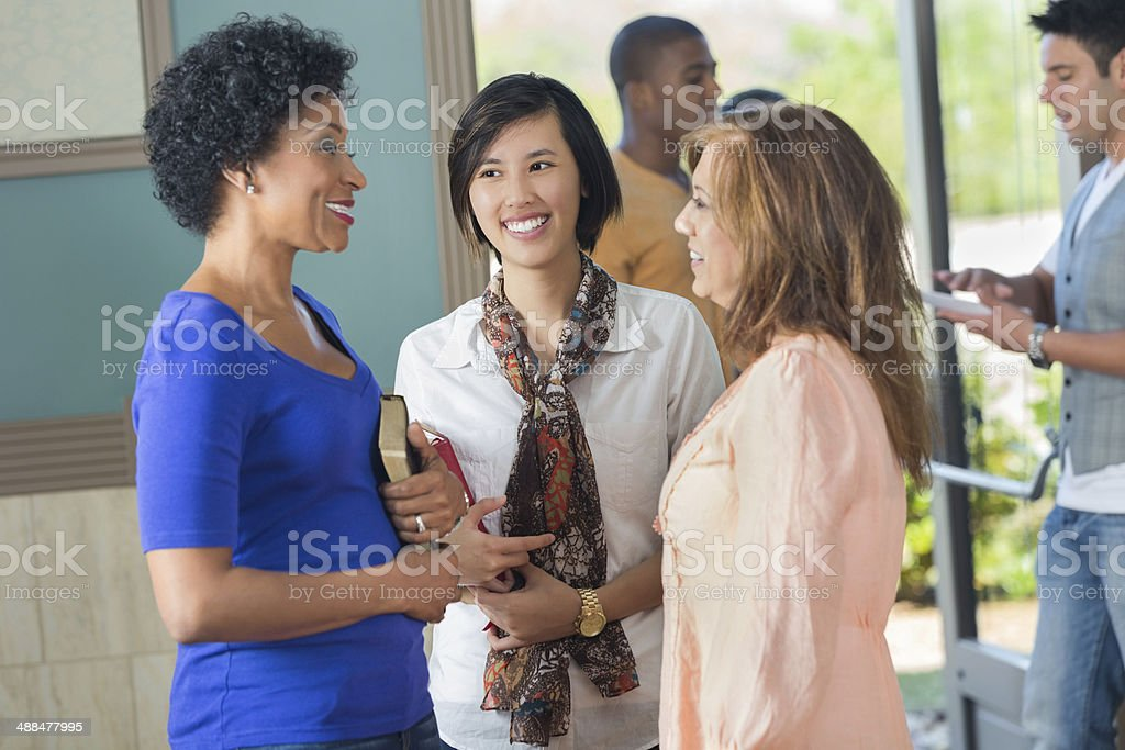Women in discussion holding Religious texts stock photo