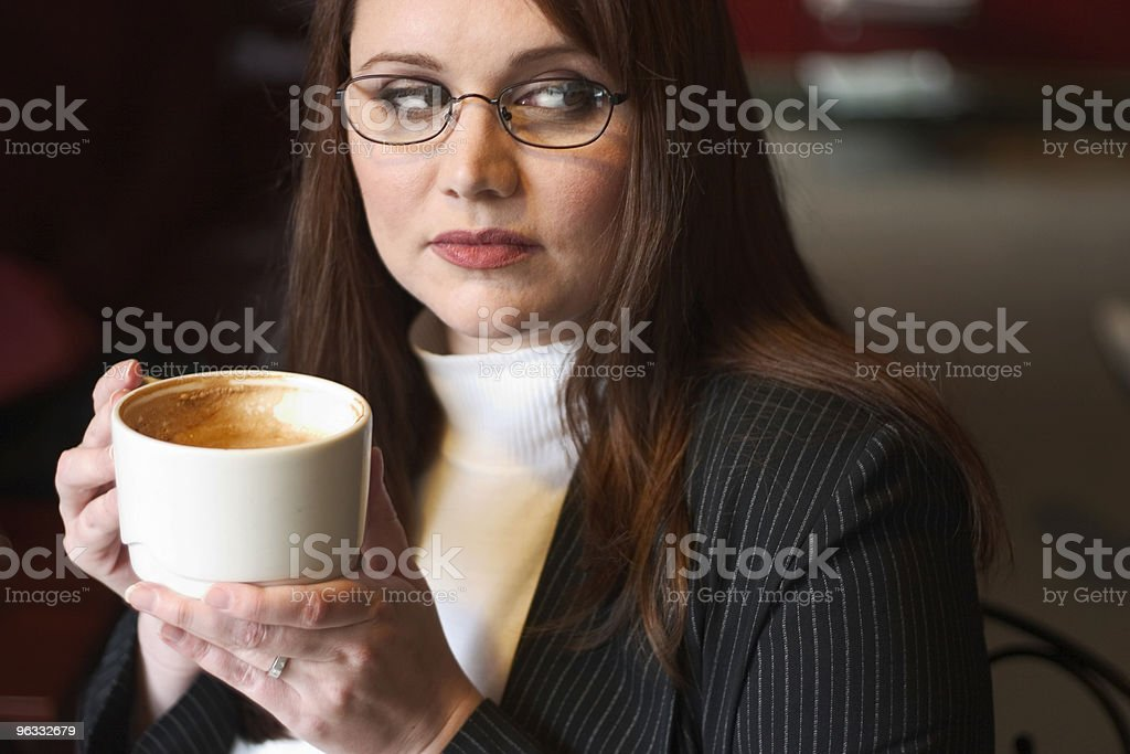 Women in glasses holding coffee eavesdrops stock photo