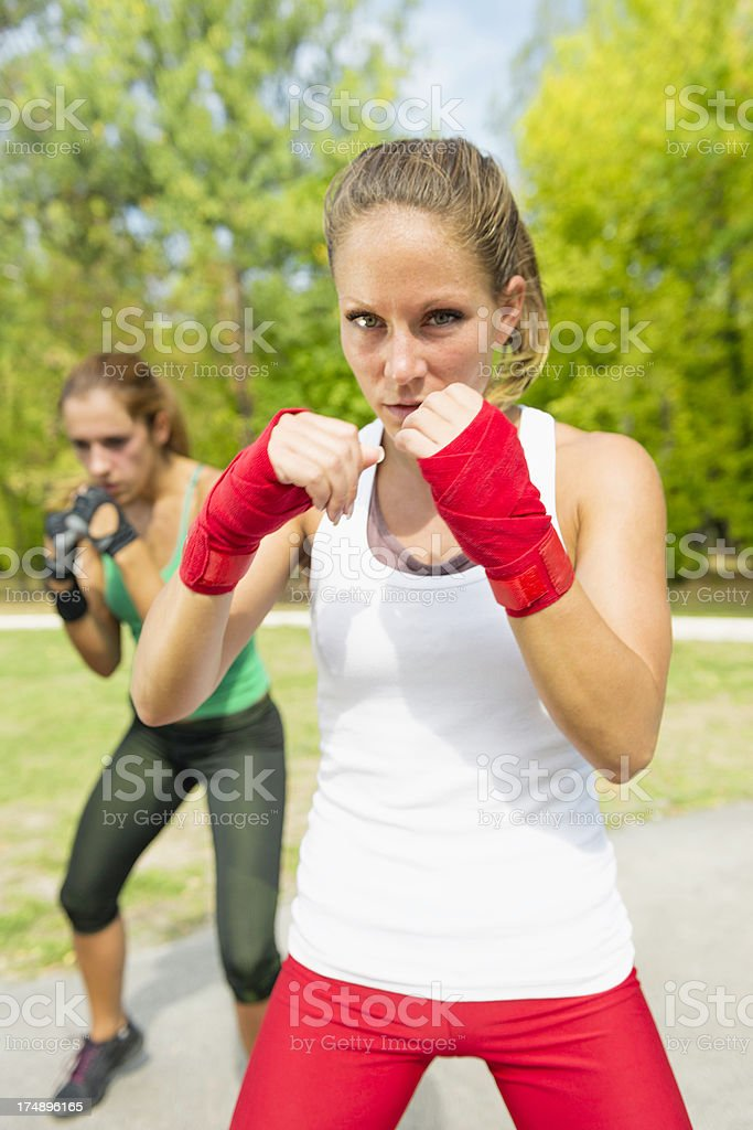 Women in guard position on TaeBo royalty-free stock photo