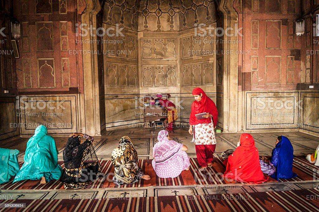 Women in Jama Masjid Mosque stock photo