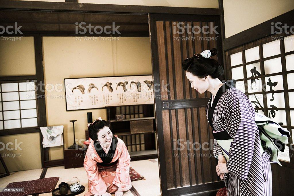 Happy beautiful Japanese women in kimono parting after having matcha...