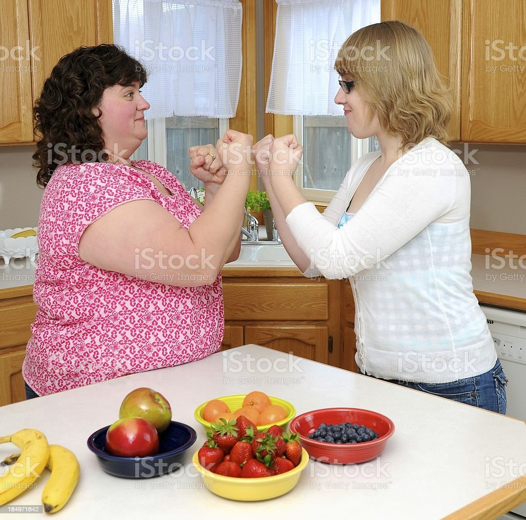 Women in Kitchen with Fruit royalty-free stock photo