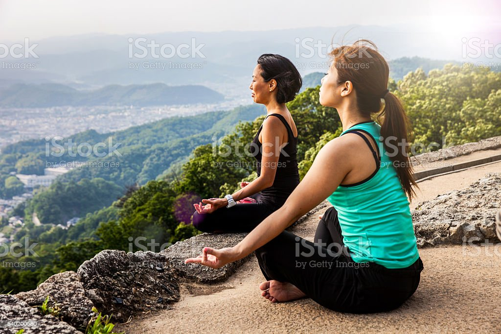 Women in meditation, doing Yoga in Japan stock photo