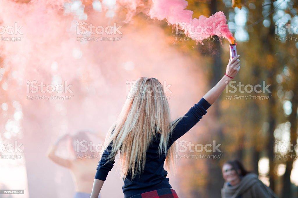 Women in pink smoke stock photo