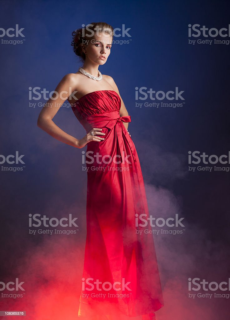 Women in red dress stock photo