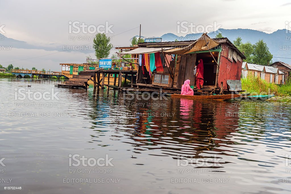 Women in Salwar Kameez on Lake Dal Srinagar, India stock photo
