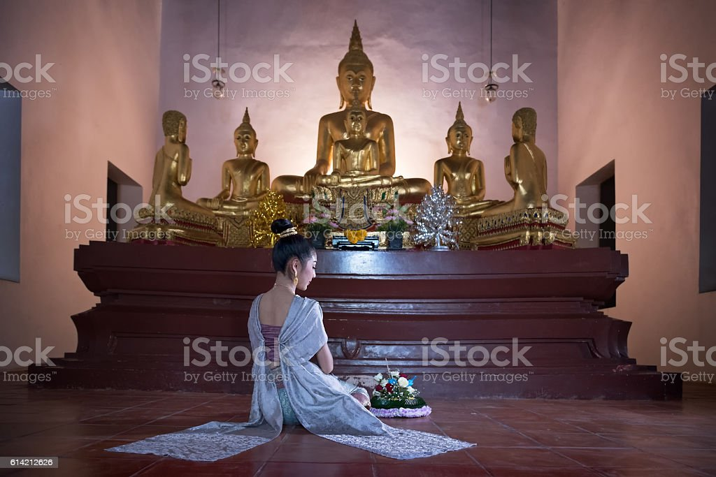 Women in thai dress at the old temple stock photo