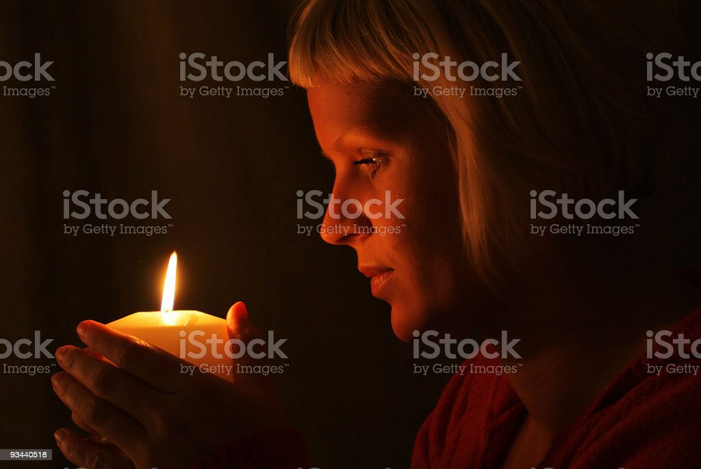Women in the candlelight royalty-free stock photo
