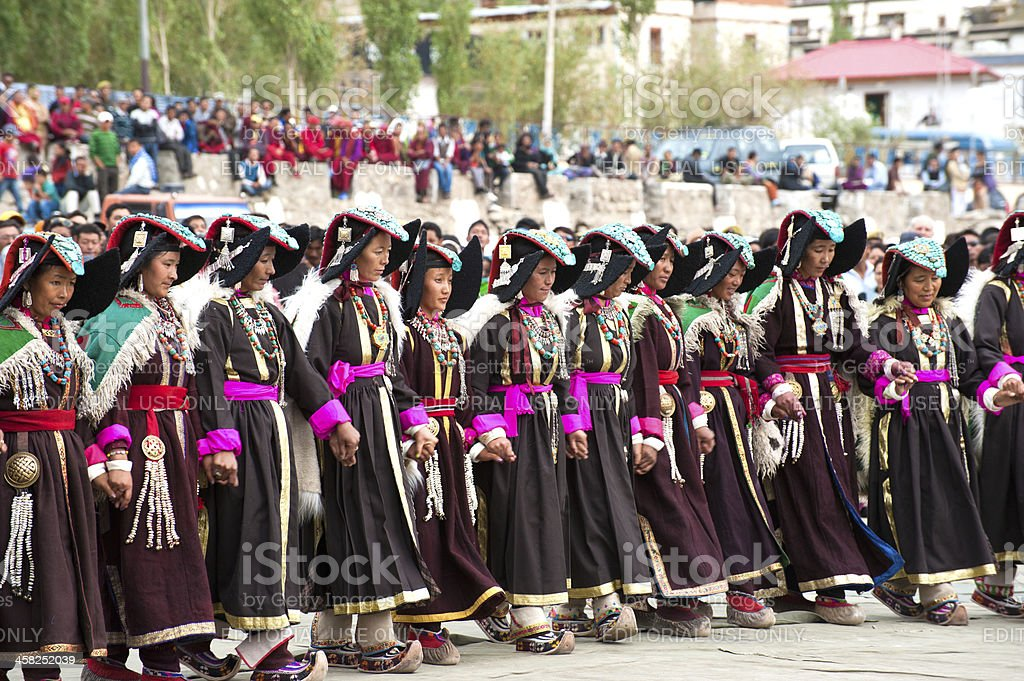 Women in traditional Tibetan clothes performing folk dance royalty-free stock photo