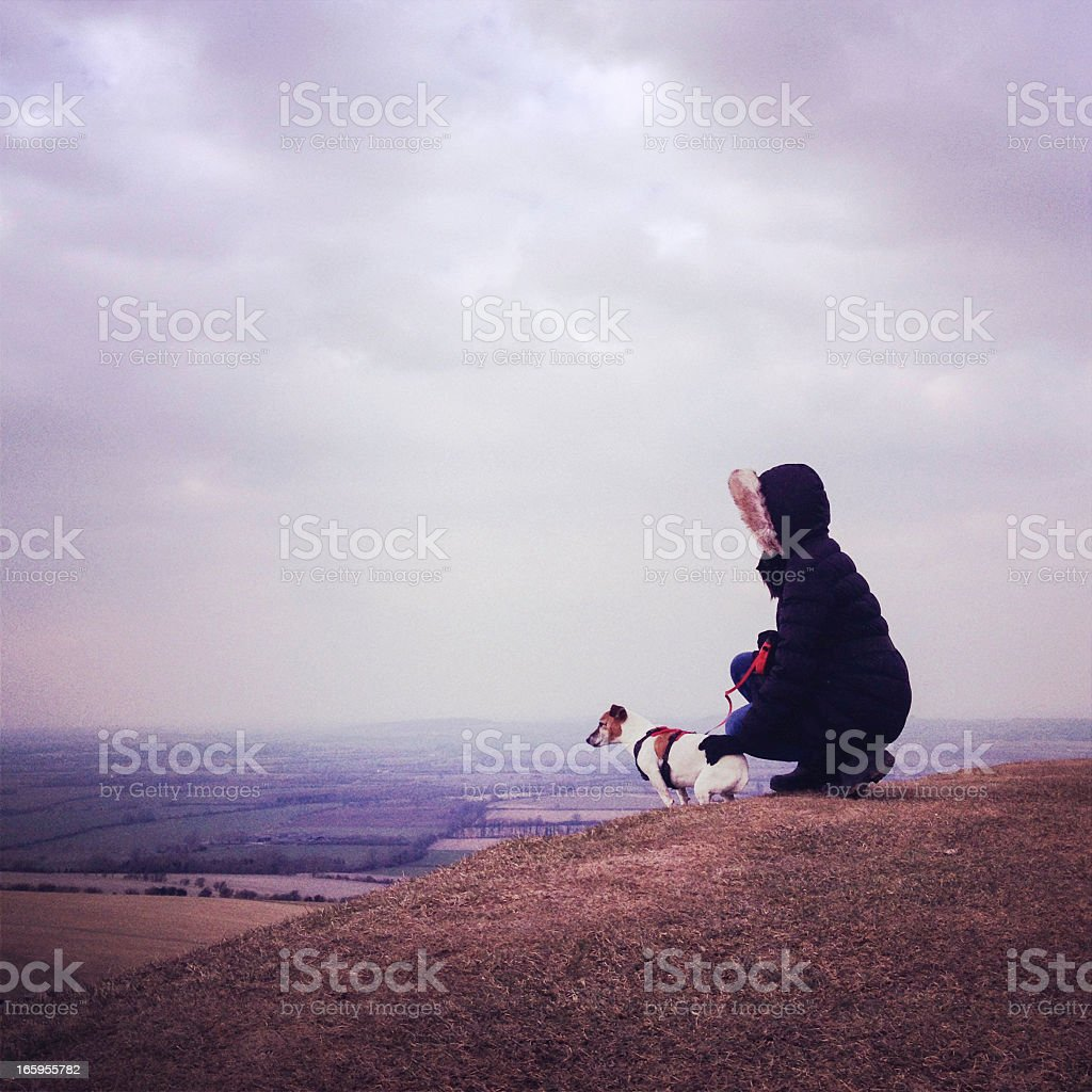 Women in winter coat with jack russell dog royalty-free stock photo