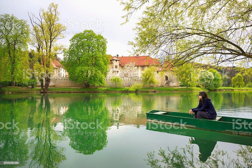 Women in wooden boat stock photo