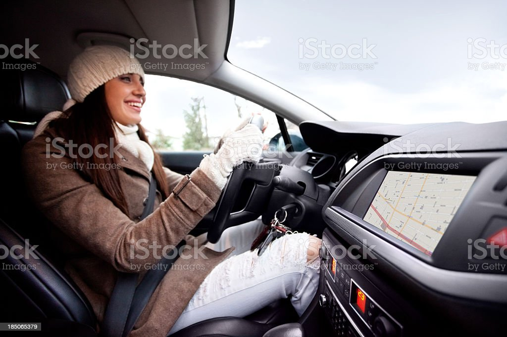 Women inside of the car, using navigational equipment stock photo