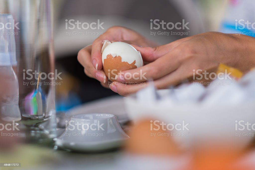 women is peeleng Egg stock photo