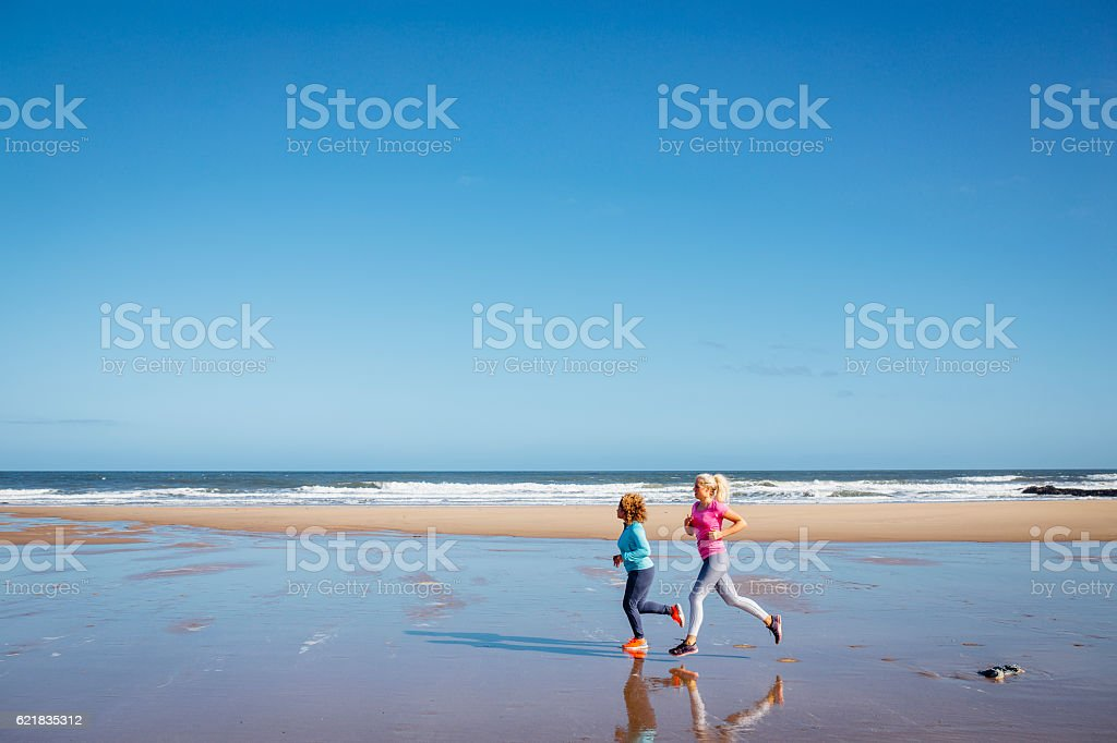 Women Jogging along a Beach stock photo