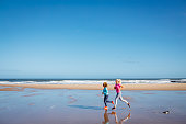 Women Jogging along a Beach