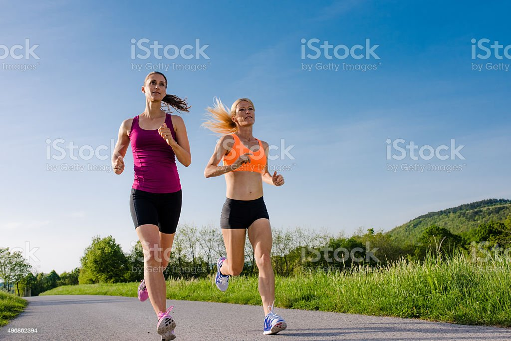 Women jogging in park stock photo