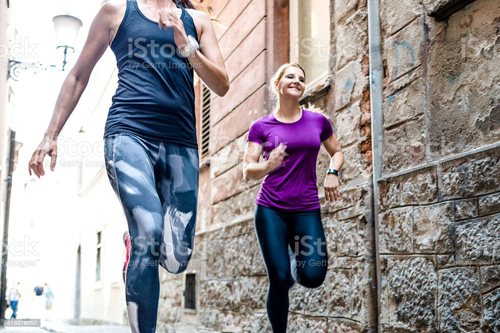 Women jogging in the city stock photo