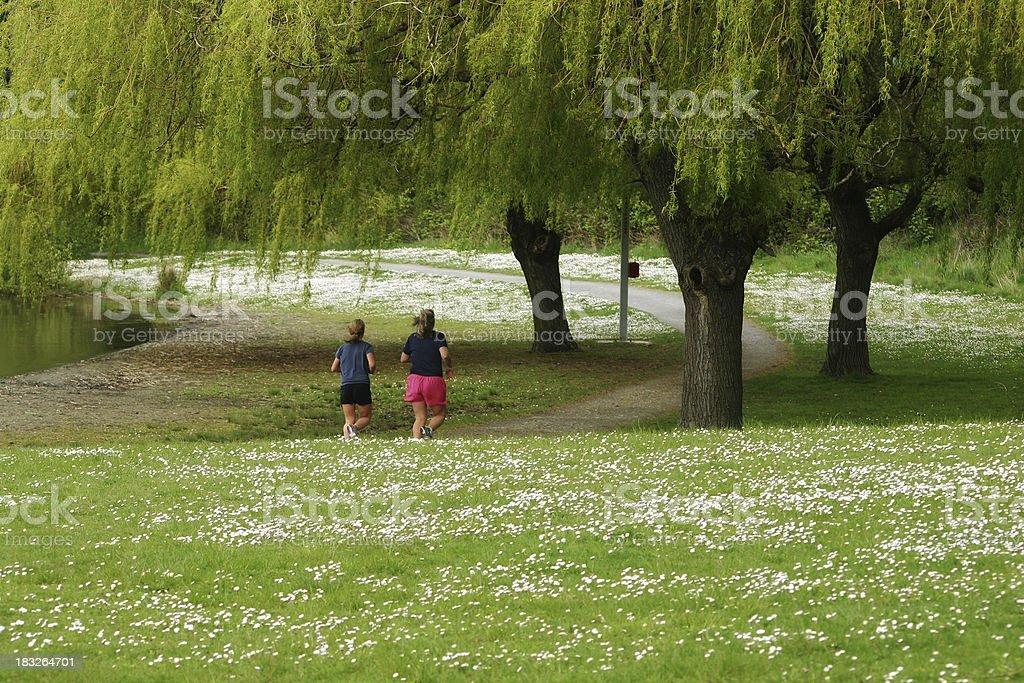 Women Jogging on path. royalty-free stock photo