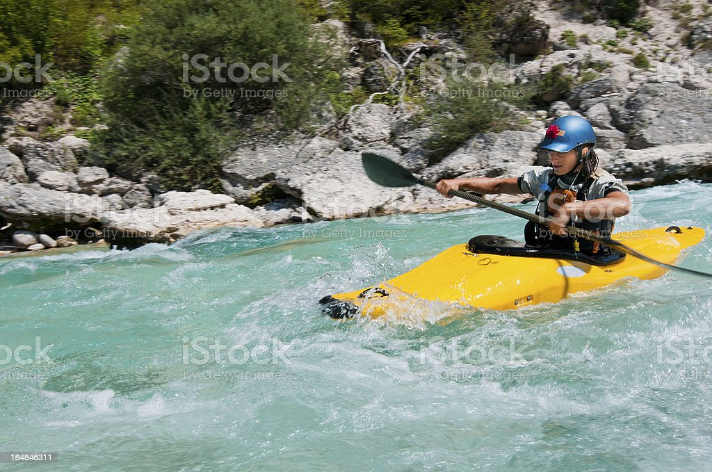 Women kayaking on turquoise mountain river royalty-free stock photo