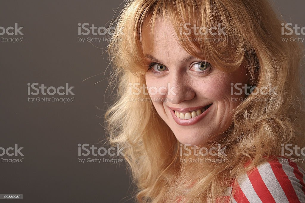 Women laugh on gray royalty-free stock photo