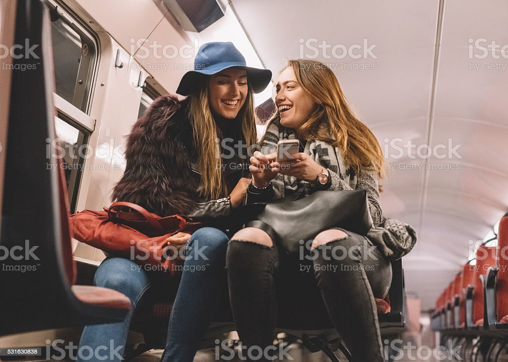 Women laughing in the subway stock photo