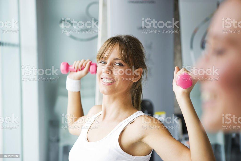 Women lifting dumbbell royalty-free stock photo