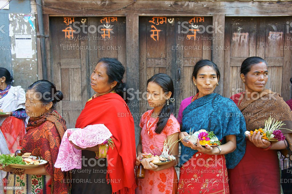 women line up at temple for puja (prayer duty) stock photo